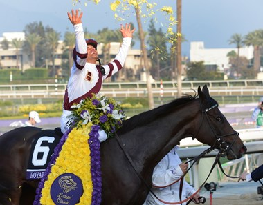 Mike Smith celebrates after Royal Delta wins the Breeders' Cup Distaff.