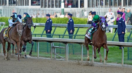 Victor Espinoza looks back at the competition on the way to winning the 140th running of The Kentucky Derby.