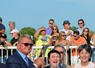Caption: Mike Ditka, presenter left, with Andrew Bentley and his parents, Mr. and Mrs. Greg Bentley.