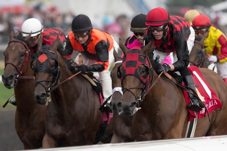 Jockey Jesse Campbell guides Midnight Aria (R) to victory in the Queen's Plate Stakes at Woodbine Racetrack.