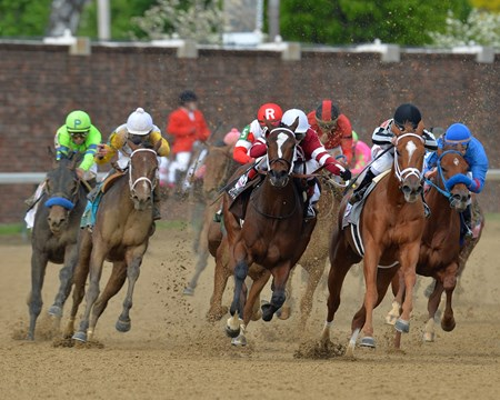 The 140th Longines Kentucky Oaks head into the first turn at Churchill Downs.