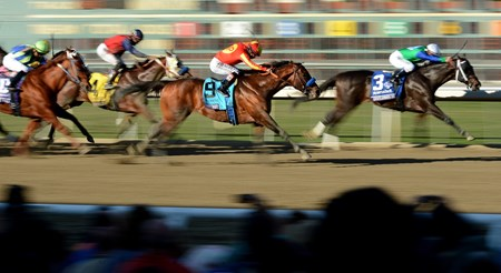 Jockey Martin Garcia guides Secret Circle (#9) past Gentlemen's Bet to win the Breeders' Cup Sprint at Santa Anita.