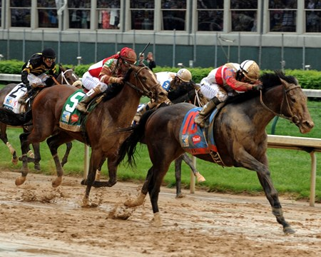 Orb passes the Kentucky Derby leaders in the final stretch.