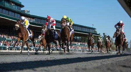 The horses roar down the stretch of the Blue Grass Stakes.