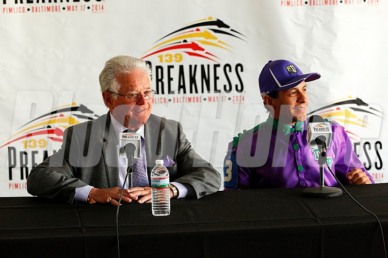 Art Sherman and Victor Espinoza smile at the post race press conference following California Chrome's win in the Preakness Stakes (gr. I) at Pimlico in Baltimore, Maryland. 