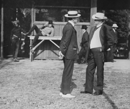 Joseph E. Widener and William C. Whitney having a chat before the races at Saratoga Race Course in  1903.
