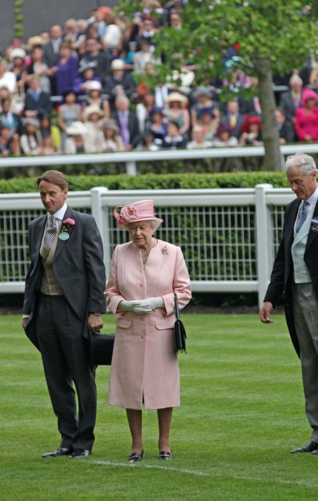 The Queen observes the One Minute silent tribute to the late Sir Henry Cecil with Johnny Weatherby (left) and Charles Barnett of The Ascot Authority before the first race June 18, 2013.