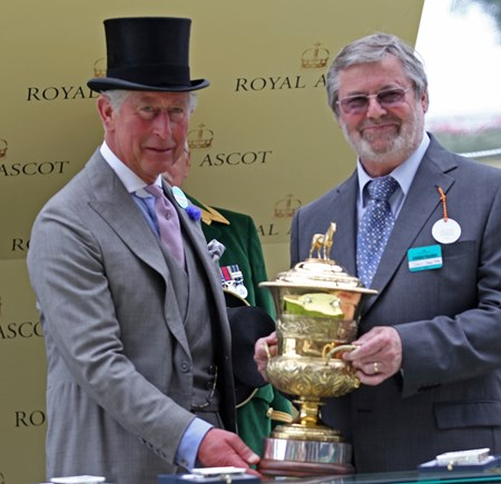 Mr. D. Deer receives the trophy from the Prince of Wales after Al Kazeem's victory in the Prince of Wales's Stakes June 19, 2013.