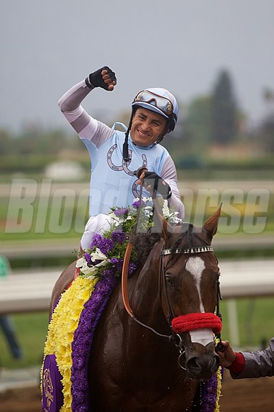 Rafael Bejarano celebrates after winning the Grade I Breeders' Cup Dirt Mile atop Goldencents.