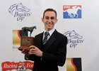 Ramon Dominguez with one of the three Eclipse Awards he won when Rushing had his book
