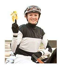 Jockey Amelia Green celebrates her first win.