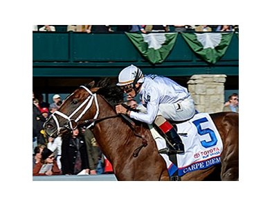 "Carpe Diem takes the Blue Grass Stakes.<br><a target=""blank"" href=""http://photos.bloodhorse.com/AtTheRaces-1/At-the-Races-2015/i-j9GjdGx"">Order This Photo</a>"