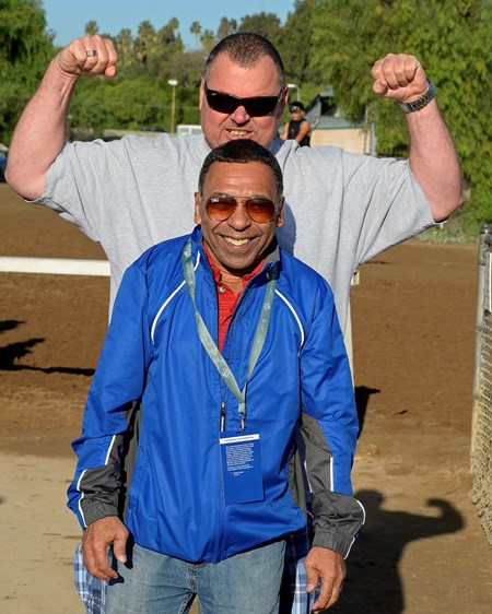 Caption:  Eric Guillot and Angel Cordero Jr. mug for the camera
