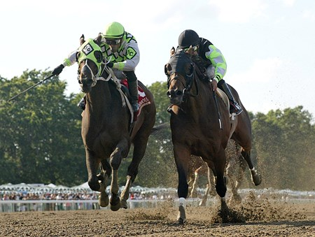 Raging Daoust (L) and Victor Santiago edges out Big Sur (R) and Ramon Moya to win the $150,000 Salvator Mile at Monmouth Park in Oceanport, N.J.