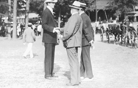 E.R. Thomas, R.C. Hooper and J. E. Widener have a chat before the races at  Saratoga Race Course in 1903.