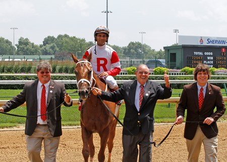 Ken Ramsey, with son Jeff (far left) and grandson William (far right), led The Sixties into the Churchill Downs winner's circle on Thursday. The Sixties, ridden by Shaun Bridgmohan, gave the Ramseys their 28th win of the Spring Meet, a single-season record for wins by an owner at Churchill Downs. The old record of 27 was set by A.J. Foyt Jr. at the 93-day Spring/Summer Meet in 1984.