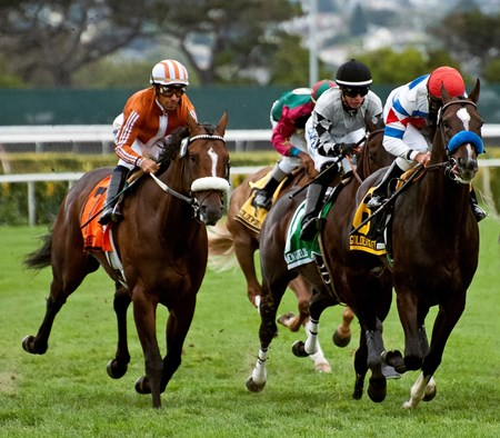 Surfcup and jockey Russell Baze wins the 2013 Silky Sullivan Stakes at Golden Gate Fields in California.