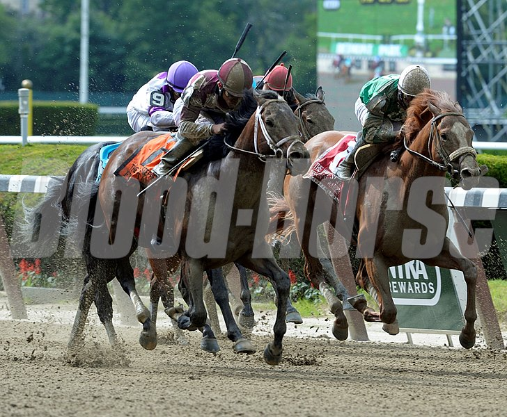 Forty Tales, left ridden by Joel Rosario comes flying on the outside to win the 29th running of The Woody Stephens at Belmont Park.
