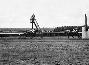 Assault posts a three-length win in the 1946 Belmont Stakes to sweep the Triple Crown