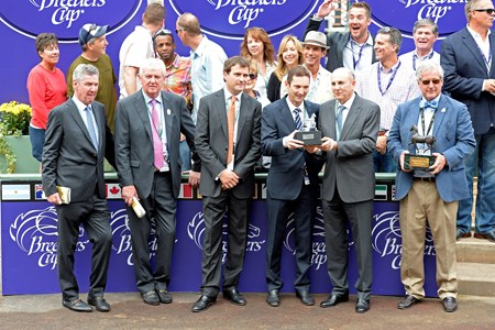 Winning connections after Hootenanny's victory in the Grade I Breeders' Cup Juvenile Turf.