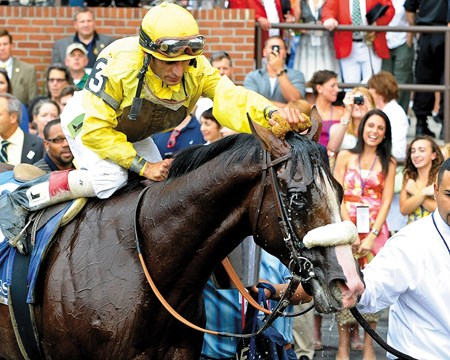 Caption: Velazquez cools off Union Rags in the winners circle.