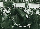 Owner Nelson Bunker Hunt and jockey Ron Turcotte with Dahlia after winning the Man o' War Stakes Dec. 18, 1974.