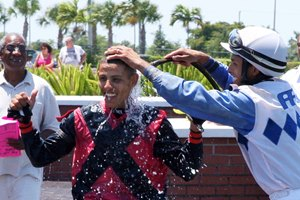 Apprentice jockey Jean Pierre Vallellanes celebrates after earning his first career victory aboard El Cowboy  this weekend at Calder Race Course.