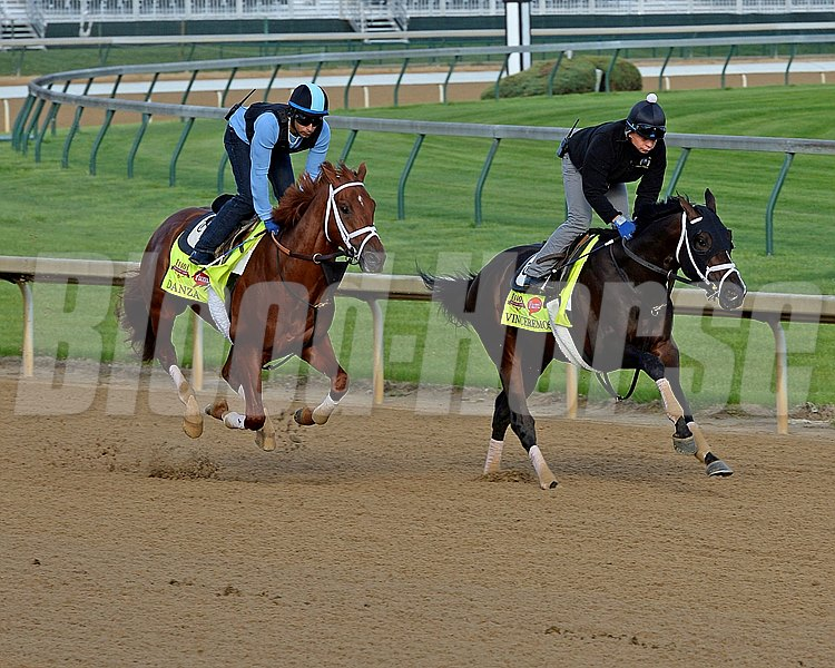 Caption: Danza, left, and Vinceremos after their work in front of the historic TwinSpires.