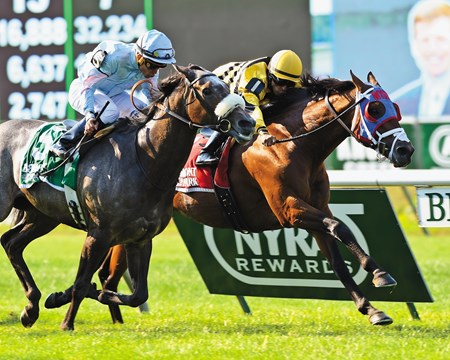 Hangover Kid, surging along the inside in the final furlong, produced a head-bobbing victory over odds-on Grandeur in the $200,000 Grade II Bowling Green Handicap, the 6-year-old's first graded stakes score at Belmont Park.