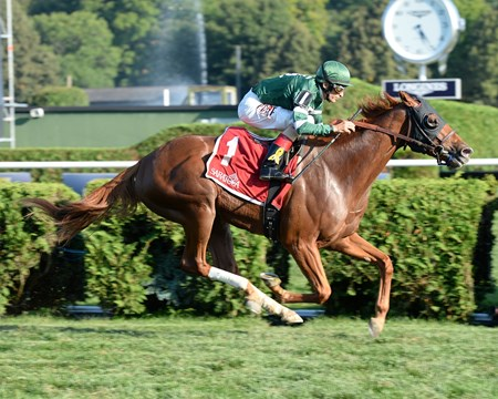 Ring Weekend and jockey John Velazquez win the Grtade III Saranac Stakes at Saratoga Race Course on September 1, 2014.