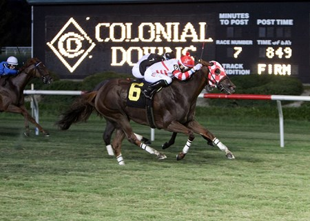 Lion Down By Me and jockey Xavier Perez are victorious in yhe 15th Running of the Oakley Stakes at Colonial Downs in New Kent, Virginia.