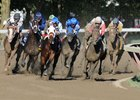 The field comes around the final turn in the  Travers Stakes at Saratoga Race Course in New York.