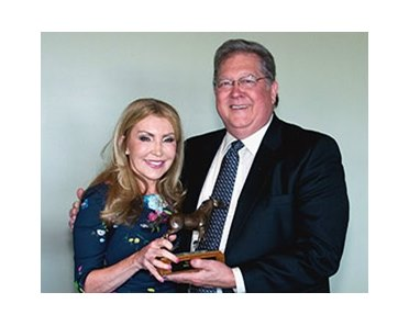 LTBA President Dr. Dexter Gary presents the 2012 Louisiana Horse of the Year award to Evelyn Benoit of Brittlyn Stables for Star Guitar.