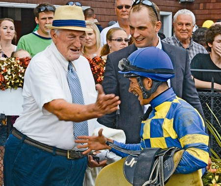 Trainer H. Allan Jerkens gives jockey Junior Alvarado a playful tap on the cheek after he rode Emma's Encore to the win in The Prioress Stakes at the Saratoga Race Course in Saratoga Springs, N.Y. August 4, 2012.   (Skip Dickstein