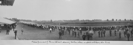 Scene from end of grandstand at Saratoga Race Course showing bookmakers watching a race in 1904.