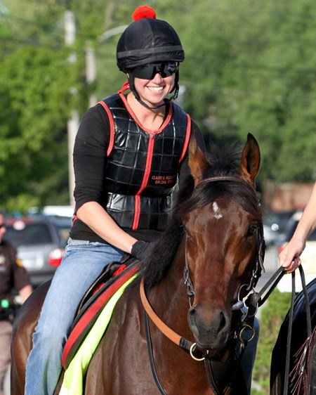 Jen Patterson is all smiles aboard to derby favorite, Orb as they head to the track at Churchill Downs on May 2, 2013.
