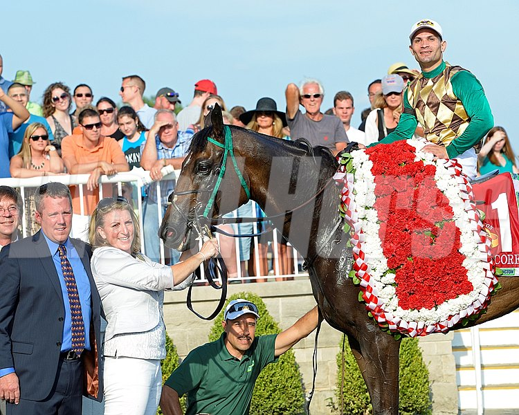 Trainer Ed Graham with Hardest Core and jockey Eriluis Vaz after winning the Arlington Million.