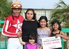 Jockey Jorge Carreno celebrates his 1,000th career win.