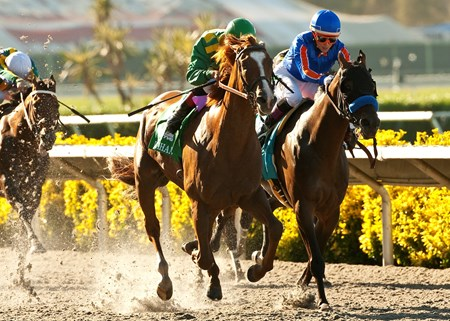 Donegal Racing's Dullahan and jockey Joel Rosario, left, fly by Game On Dude (Chantal Sutherland), right, to win the Grade I, $1,000,000 Pacific Classic, Sunday, August 26, 2012 at Del Mar Thoroughbred Club, Del Mar CA.  The 3-year-old son of Even the Score set a track record, covering the 1 1/4 miles in 1:59.54 (former record 2:00.61).