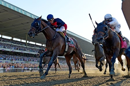 Tonalist leads late in the final stretch as the Belmont Stakes field approaches the finish line.
