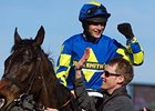 Ryan Mania celebrates victory aboard Auroras Encore in the Grand National.