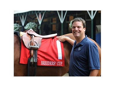 Breeders' Cup President Greg Avioli displays new colored Breeders' Cup saddle towel.