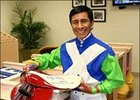Jockey Edgar Prado holds the saddle that he used to ride Barbaro in the 2006 Kentucky Derby which he has signed and is donating to a special auction to benefit permanently disabled jockeys.