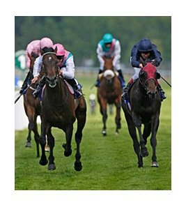 "Twice Over (left) leads the way to victory in the Coral-Eclipse Stakes. <br><a target=""blank"" href=""http://www.bloodhorse.com/horse-racing/photo-store?ref=http%3A%2F%2Fpictopia.com%2Fperl%2Fgal%3Fprovider_id%3D368%26ptp_photo_id%3D9094352%26ref%3Dstory"">Order This Photo</a>"