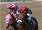 Commentator (right) survives late surge by Saint Liam to win the Whitney.