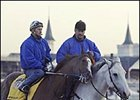 Trainer Steve Asmussen, right, on pony, accompanying Quintons Gold Rush to the track at Churchill Downs.