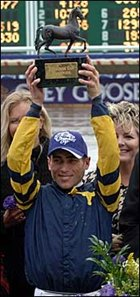 Garrett Gomez celebrates in the Winner's Circle after winning the 2007 Breeders' Cup Juvenile Fillies with Indian Blessing.