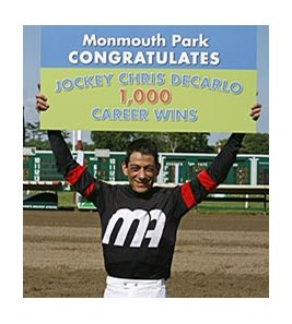 Jockey Chris DeCarlo celebrates the 1,000th winner of his career at Monmouth Park June 23.
