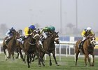 Mahbooba (blue cap, outside) rolls home to win the Balanchine Stakes at Meydan.