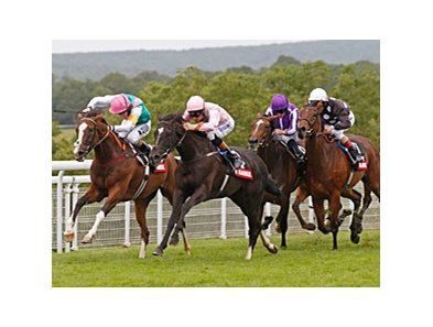 "The Fugue (right, pink silks) overtakes Timepiece (left) to win the Nassau Stakes.<br><a target=""blank"" href=""http://photos.bloodhorse.com/AtTheRaces-1/at-the-races-2012/22274956_jFd5jM#!i=2005841112&k=RRsMqHB"">Order This Photo</a>"